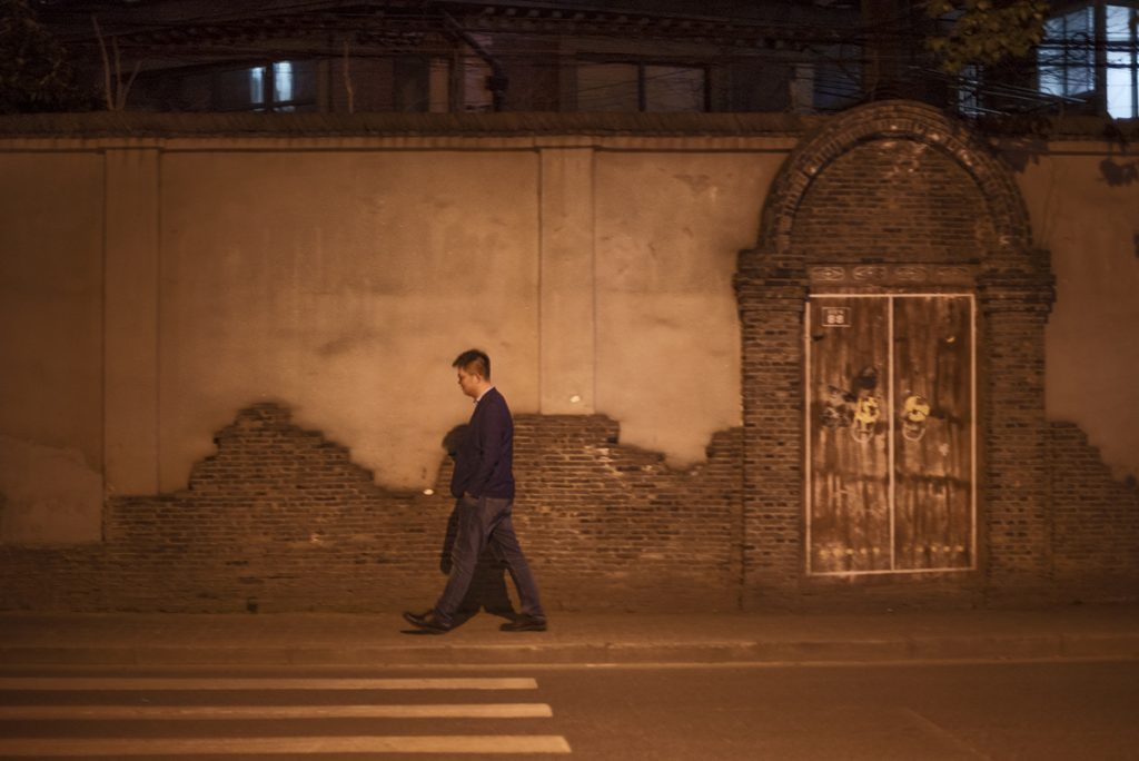 lonely man walking in China