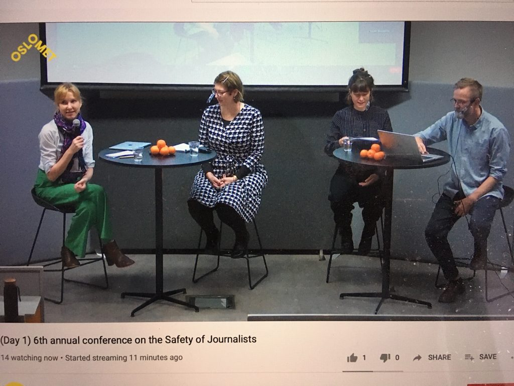 4 people siting on a stage talking