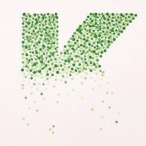 Motiv utført i pointillisme, bokstaven K.