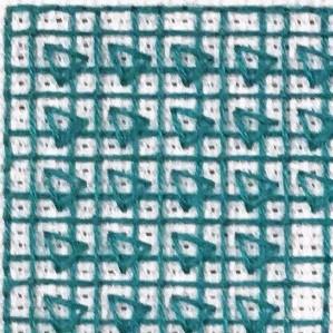 Nærbilde av bunnsøm med dekorative trekanter fra bokstaven E.