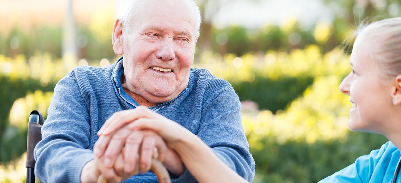 Older man at nursing home talking to nurse. Photo: colourbox.com
