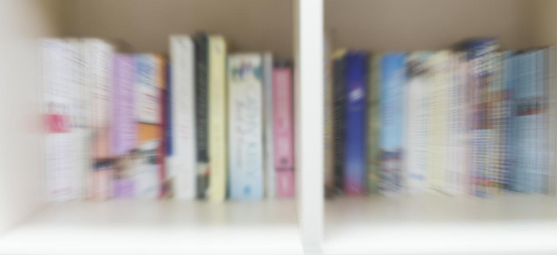 Books on a shelf. blurry. colourbox