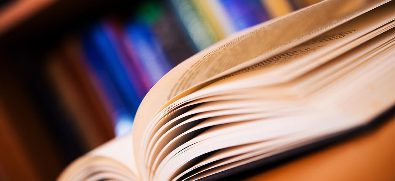 Books Reading Concept Photo. Open Book Closeup.