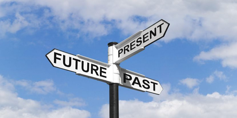 Concept image of a Future Past Present signpost against a blue cloudy sky